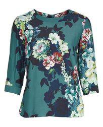 Блуза нежно-голубого цвета с цветочным принтом BL 825